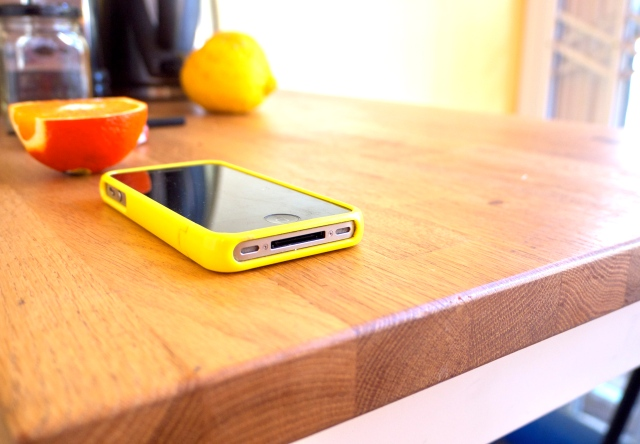 Lemon and Orange with iPhone on Table