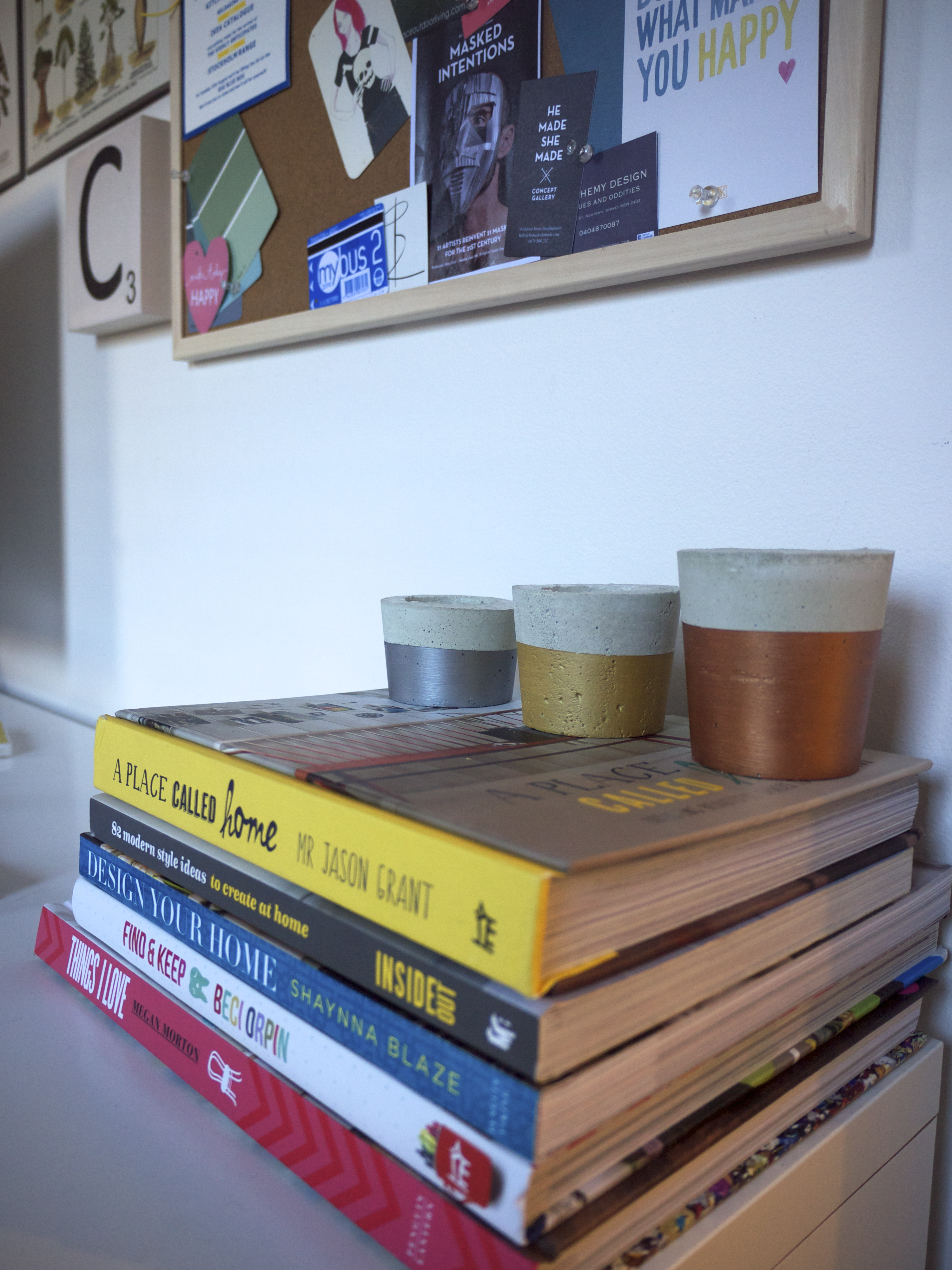 The Life Creative Headquarters - Office Space - Books and Cement Candle Holders
