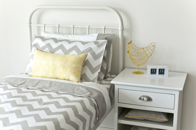 Incy Interiors - Single Bed with Chevron Bedding and Side Table